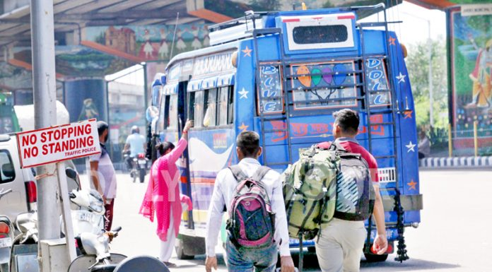 Matador takes a break to carry passengers at 'No Stop' zone at Vikram Chowk in Jammu. —Excelsior/Rakesh