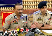 Director General of Police Dilbag Singh flanked by IGP S P Pani addressing a press conference in Srinagar on Wednesday. —Excelsior/Shakeel