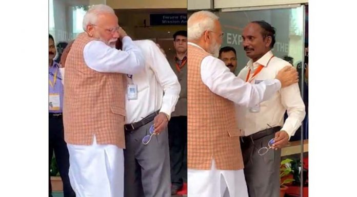 Prime Minister Narendra Modi consoles ISRO Chairman Kailasavadivoo Sivan as he got emotional after the Vikram lander connection was lost during soft landing of Chandrayaan 2 on lunar surface in Bengaluru.