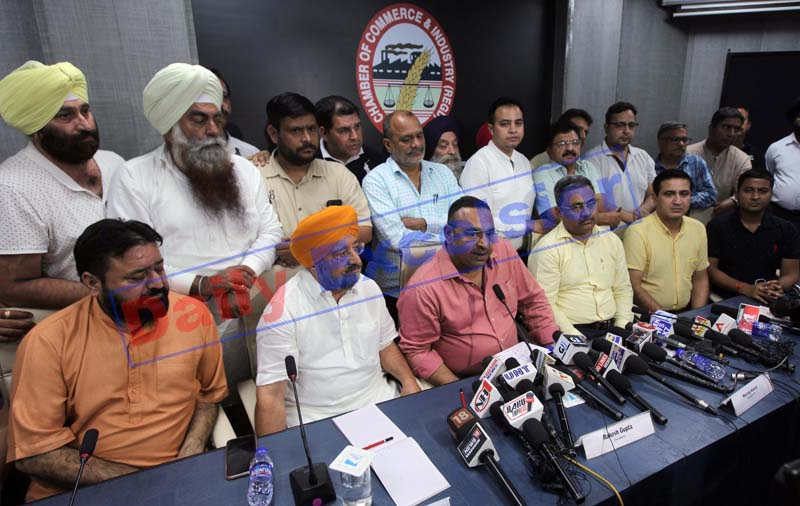 JCCI president Rakesh Gupta, flanked by T S Wazir chairman, JKTWA and president CTF, Neeraj Anand addressing press conference in Jammu on Thursday. -Excelsior/Rakesh