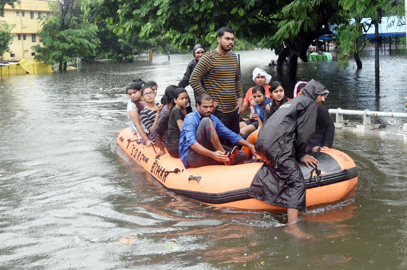 State Disaster Response Force (SDRF) workers rescue people from flood-affected area of Rajendra Nagar in Patna on Sunday. (UNI)
