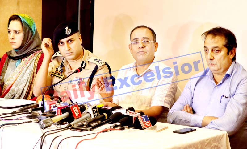 Government spokesman Rohit Kansal along with other officials addressing a press conference in Srinagar on Thursday. -Excelsior/Shakeel