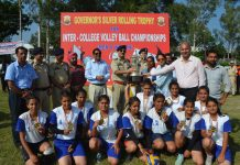Dr SD Singh Jamwal, Director SKPA Udhampur presenting title trophy to winning team.