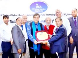 Chairman DPS Udhampur Dr JC Gupta and MD Vivek Gupta receiving National School Excellence Award from diginitaries.