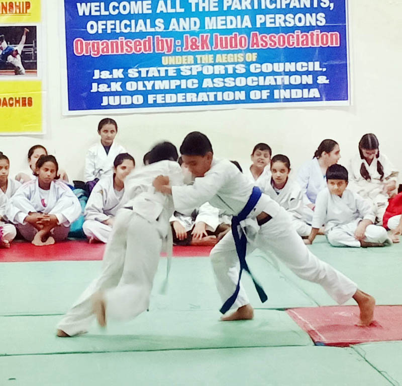 Players in action during their bout in the ongoing Jammu District Judo Championship at MA Stadium Jammu on Sunday.