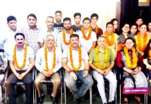 Newly elected office bearers of Tawi Trekkers J&K posing for a group photograph on Saturday.