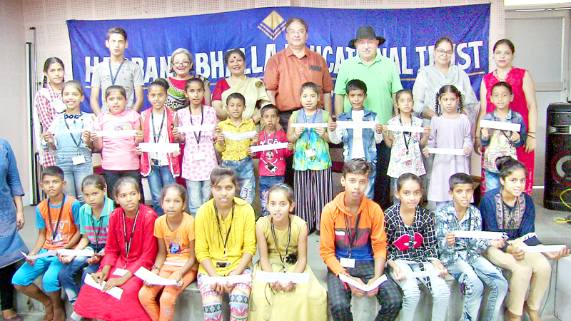 Children and dignitaries posing for group photograph during scholarship carnival.