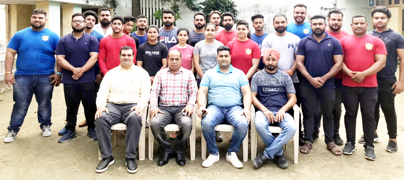 J&K players and office bearers of All J&K State Power Lifting Association posing for group photograph.