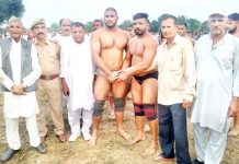 Wrestlers shaking hands before their bout. -Excelsior/Gautam