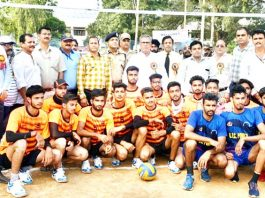 Players posing along with Advisor Farooq Khan and other dignitaries during inaugural ceremony of 5th Edition of State Level Inter Collegiate Governor's Silver Rolling Volleyball Championship.