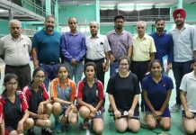 Shuttlers and and dignitaries posing for group photograph.