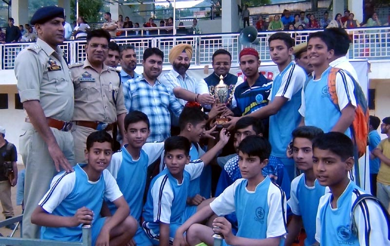 Dignitaries awarding winning team of Aman Memorial Football Tournament at sports stadium, Doda on Monday.