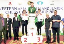 J&K's ace chess player Arushi Kotwal being honoured after winning bronze medal in Western Asian Blitz Chess Championship.