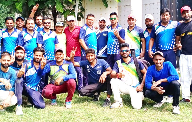 JU Employees team posing for a group photograph after scripting victory over Media XI on Sunday.