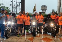 Participants of motorcycle expedition and members of JAC posing for group photograph.