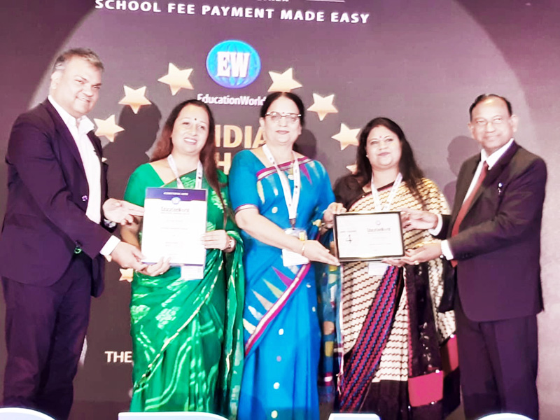 Rohini Aima, Principal, Jammu Sanskriti School, Jammu along with Nidhi Kohli and Varuna Magotra, Pre-Primary and Primary wing Co-ordinators receiving award at Gurgaon in Haryana.
