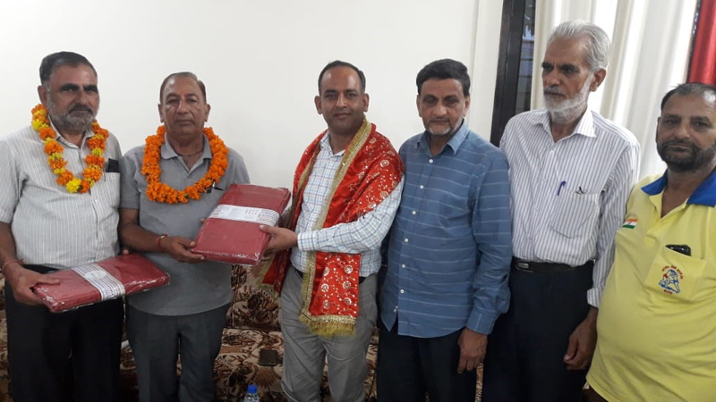 Winner of 51st Sujandhar Kesari Dangal title being felicitated by the dignitaries on Monday.