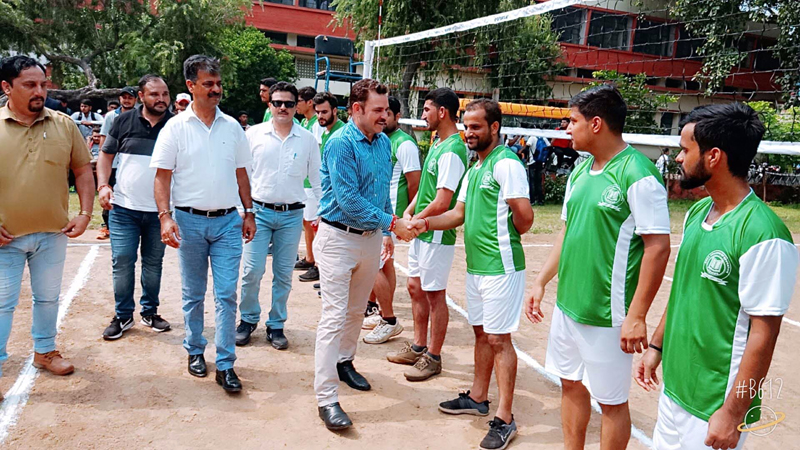 Chief Guest interacting with players during inaugural ceremony of CLUJ Volleyball Tournament in Jammu on Thursday.