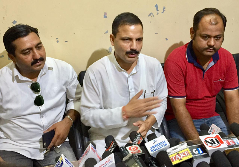 Former MLA, Balwant Singh Mankotia and other dignitaries addressing media persons in Jammu.