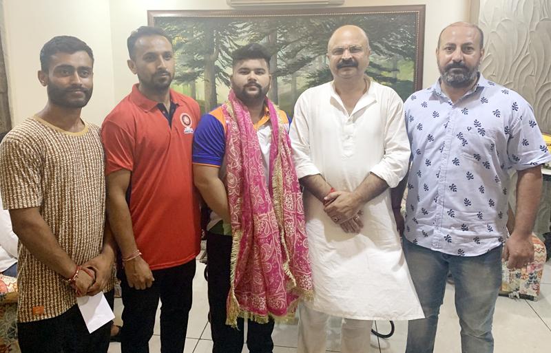 Grappler Rajeshwar Singh posing along with Yudhvir Singh during felicitation function in Jammu.