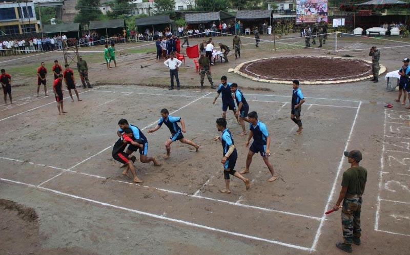 Players trying their strength in Kabaddi event at Kalakote in Rajouri.