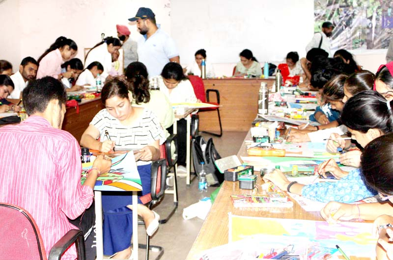 Students busy in Poster Making competition at University of Jammu on Saturday. -Excelsior/Rakesh