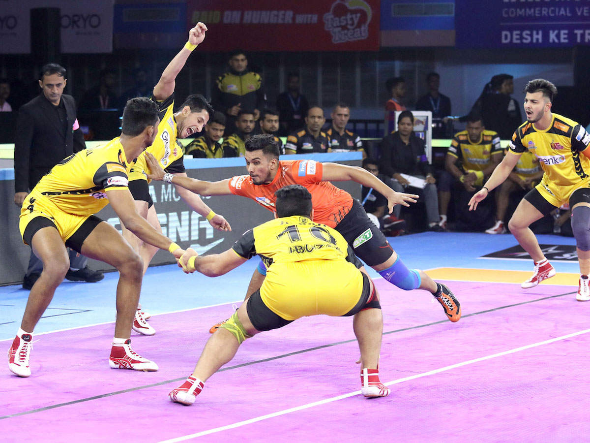 Players in action during PKL match between U Mumba and Telugu Titans in Kolkata on Tuesday.