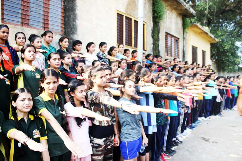 Girls taking oath during Marathon Run against drugs at Udhampur on Sunday.