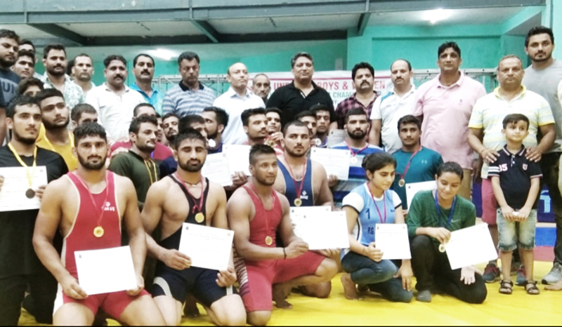 Wrestlers posing along with chief guest, Dushyant Sharma and other dignitaries in Jammu on Sunday.