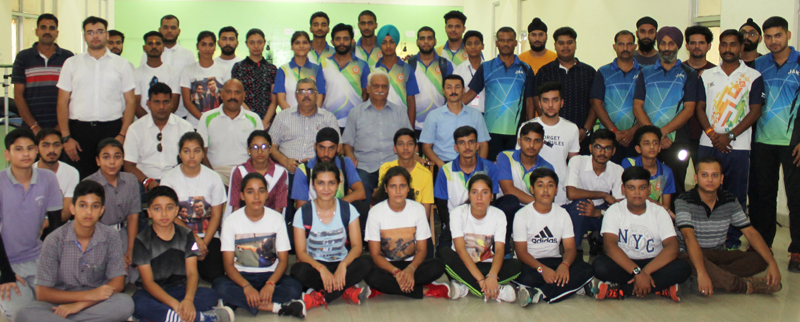Shooters posing for a group photograph along with dignitaries and officials before leaving for at Ahmedabad (Gujarat).