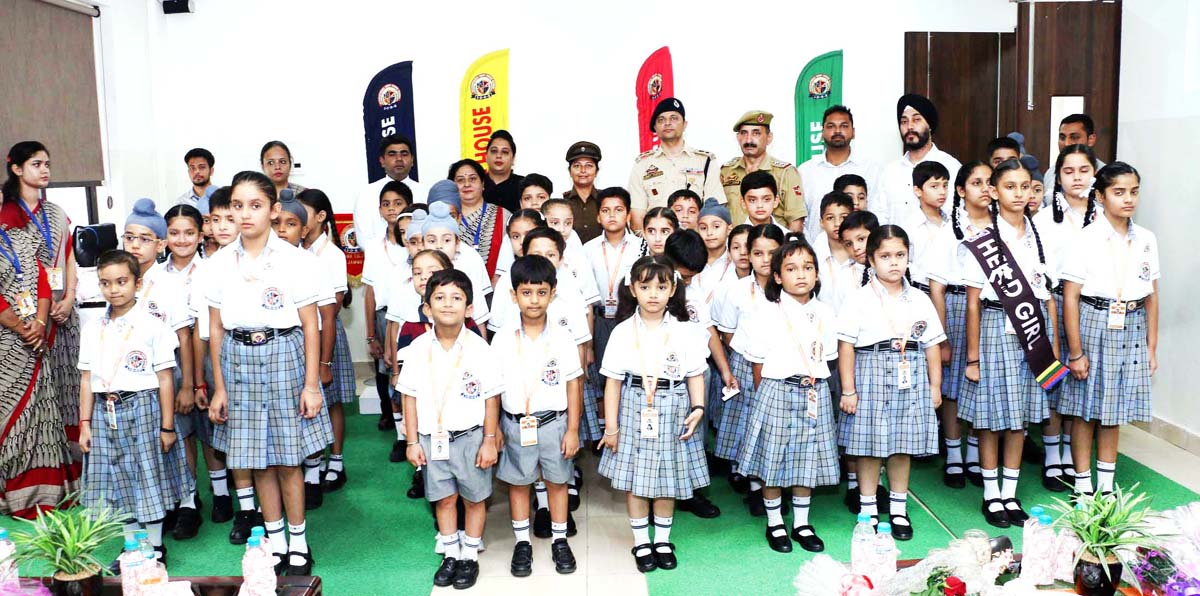 Children and dignitaries posing for a group photograph during a function organised by IDRS at Jammu.