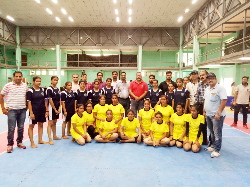 Players posing along with officers and officials during Inter-Collegiate Tournament at Jammu University.