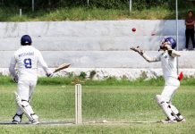 A player being caught behind the wickets during a match in Jammu University ground on Wednesday. -Excelsior/Rakesh