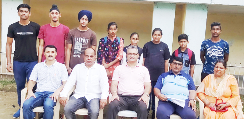 State Athletics team posing along with dignitaries and officials in Jammu on Wednesday.