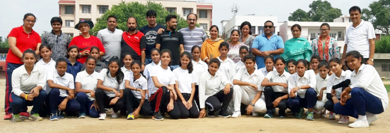 Under-19 girls teams posing along with officers and officials at Parade ground in Jammu.