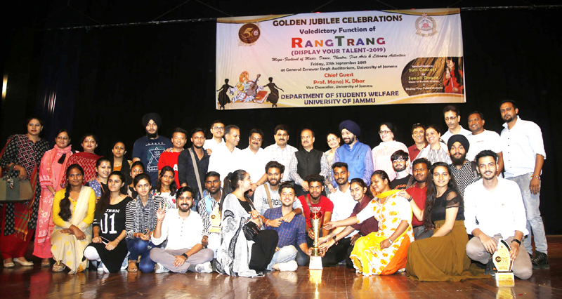 Winners of 'Rang Trang-Display Your Talent' and dignitaries posing for group photograph at Jammu on Friday. —Excelsior/Rakesh