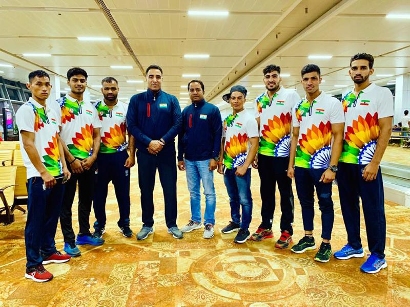 Indian Wushu team posing along with Chief Coach of India, Kuldeep Handoo before leaving for China.