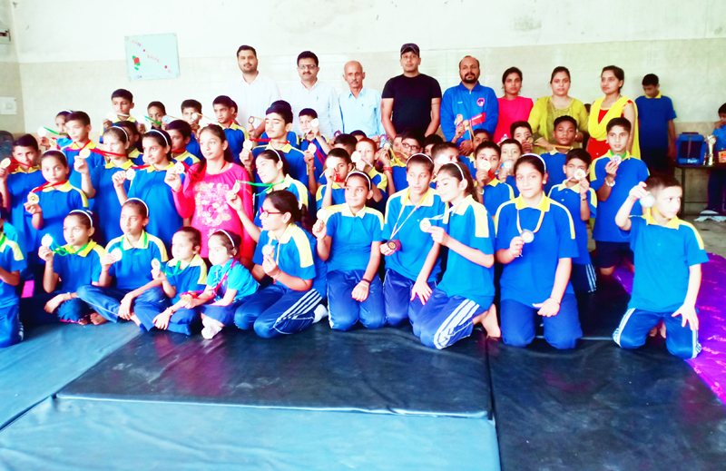 Winners of Judo Championship and dignitaries posing for group photograph.