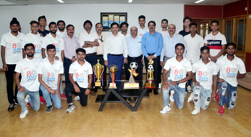 Footballers of JK Bank team posing for a group photograph along with Chairman, RK Chhibber and other dignitaries on Thursday.