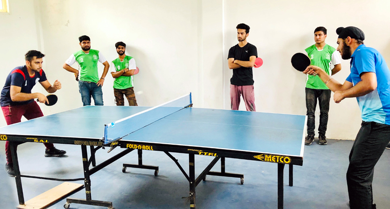 Players in action during Table Tennis match at Jammu on Friday.