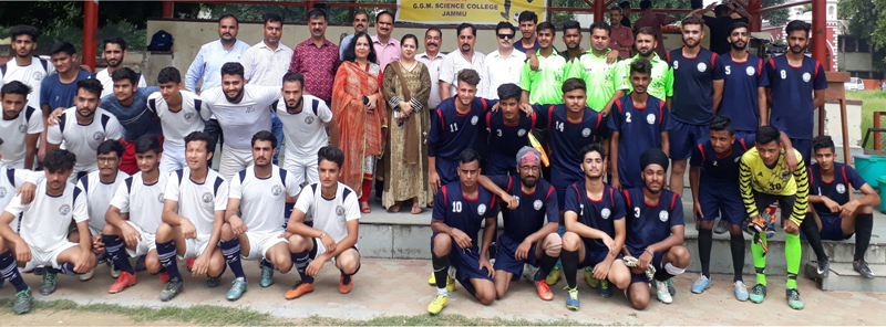 Football teams posing along with dignitaries during closing ceremony of CLUJ Football Tournament in Jammu.