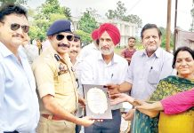 Principal GDC Udhampur Dr Nutan Kumar Resotra and others presenting trophy to SSP Mohan Lal.
