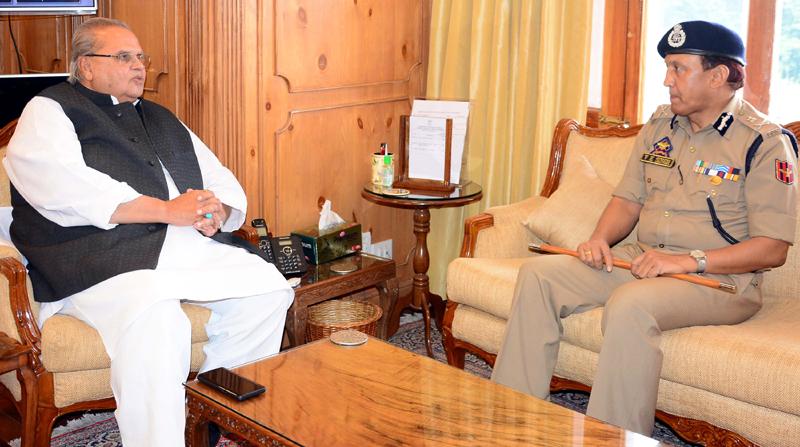 Governor Satya Pal Malik meeting DG Prisons V K Singh on Saturday.