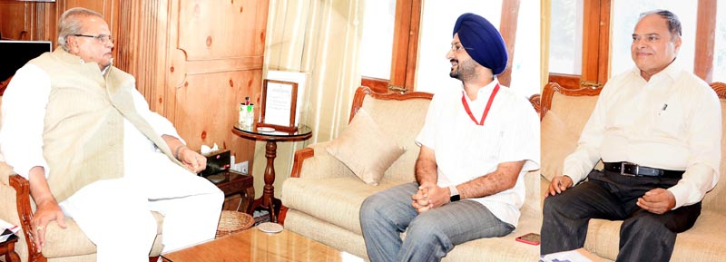 Governor Satya Pal Malik meeting with Simrandeep Singh and Jeet Lal Gupta on Tuesday.