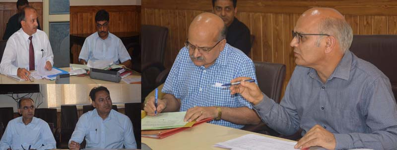 Advisor KK Sharma chairing a meeting on Wednesday.