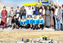 BPCL officials posing with prominent people of Ladakh in front of company's 1st retail outlet in Ladakh (left) and a distant view of the outlet (right).