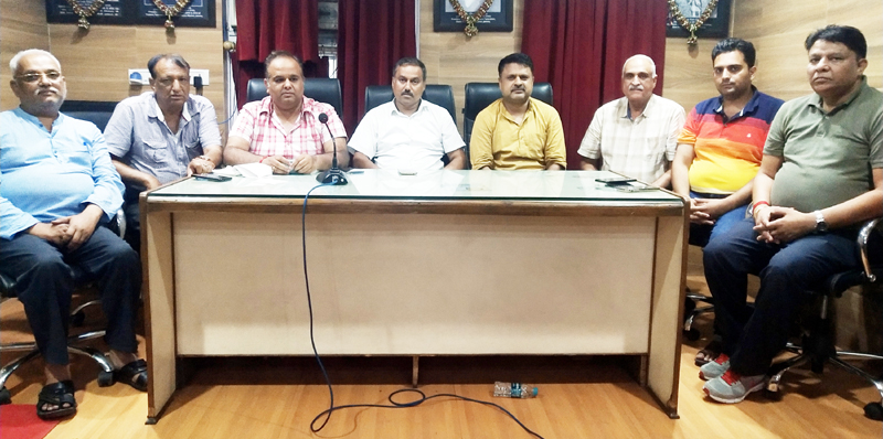 Ware House traders at a meeting in Jammu on Saturday.