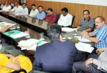 Advisor K Skandan reviewing progress on digitalization of land records during meeting in Jammu.