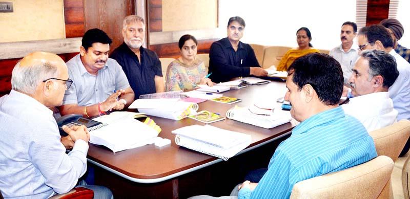 Advisor K K Sharma chairing a meeting at Srinagar on Monday.