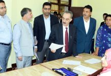 Justice Ali Mohd Magray interacting with staff at Juvenile Observation Home at Harwan in Srinagar on Saturday.